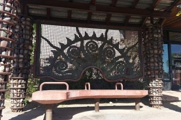 A bustop filled with rocks and iron art in Scottsdale Arizona