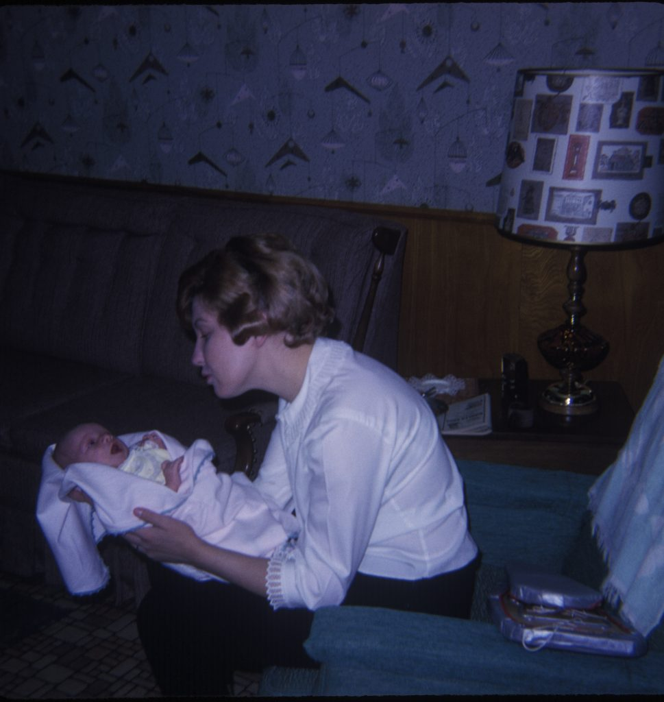 My mum holding me in a blanket a few months after I was born