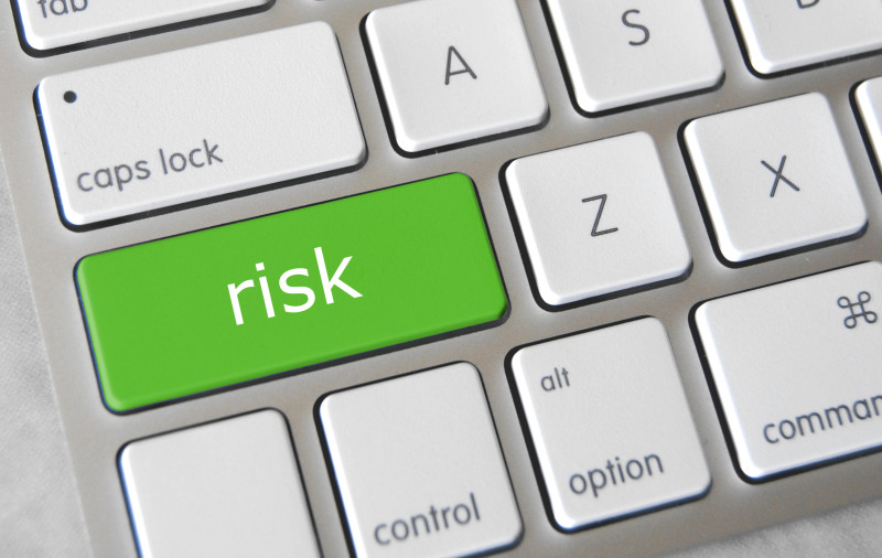 The word risk appearing as a key on a keyboard