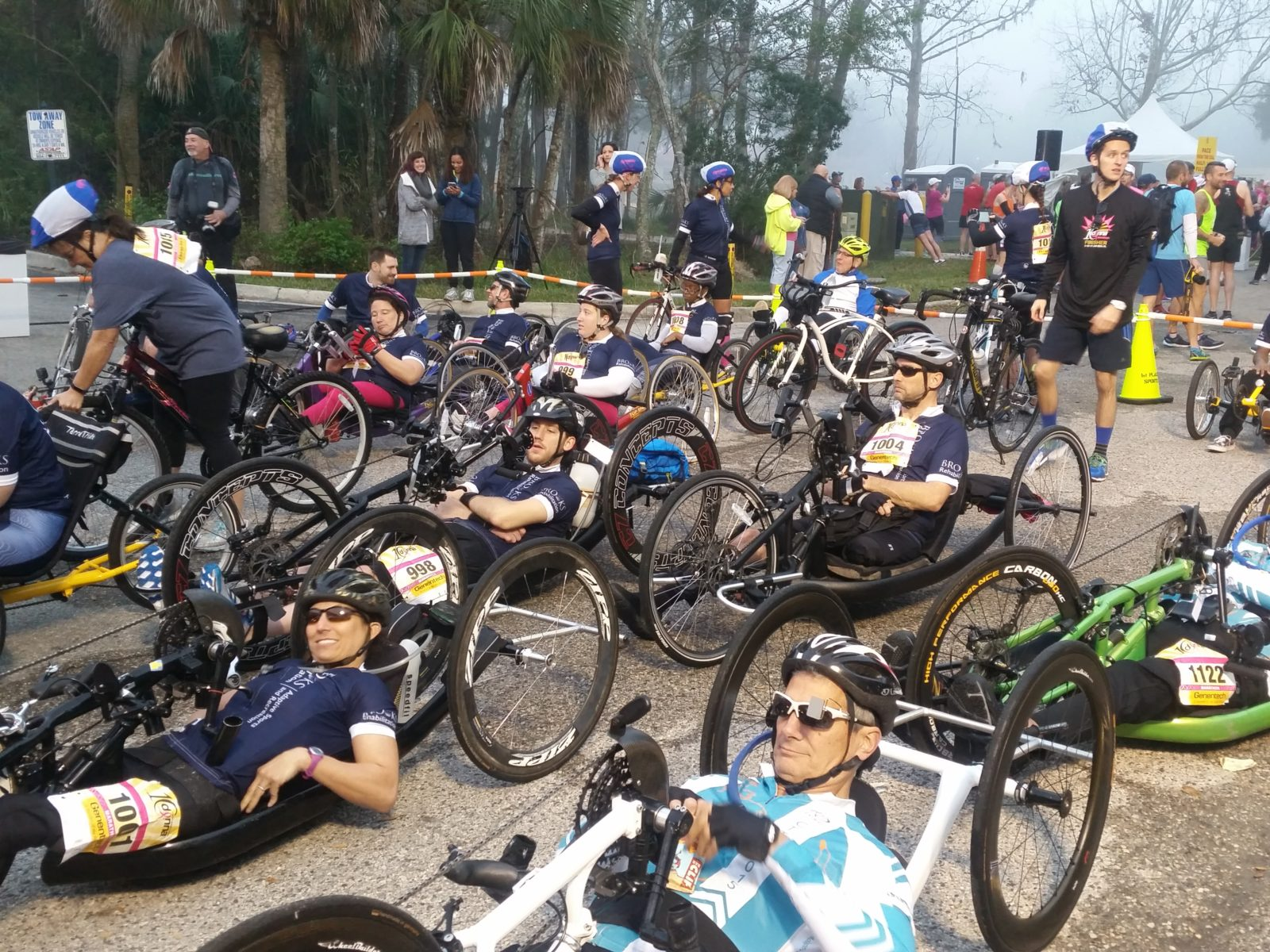 A group of male and female bikers get ready to bike 26.2 miles