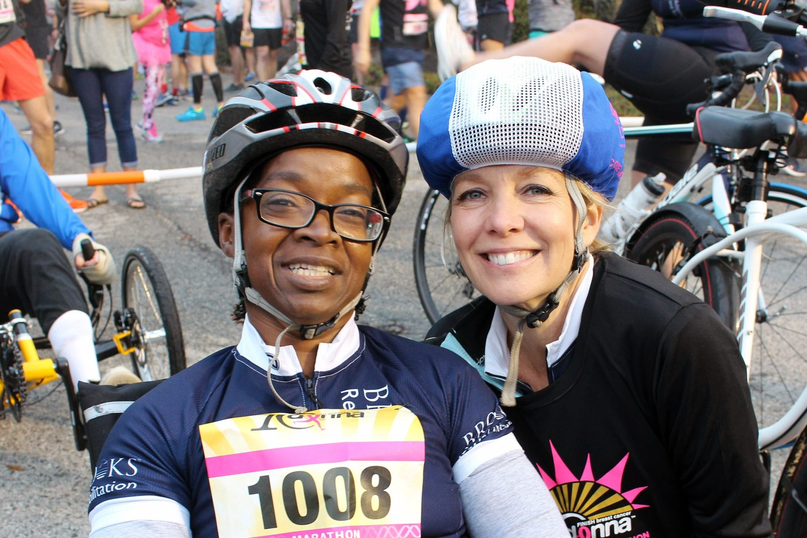 Two girls smile together as they get ready to bike 26.2 miles