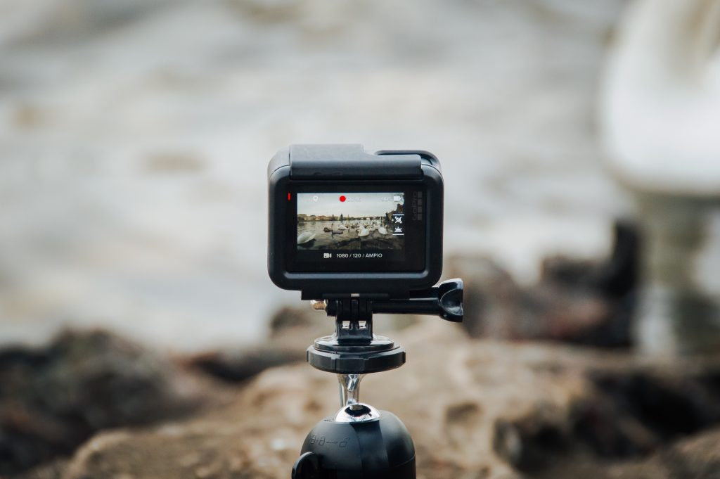 In order to have a plan to scale your business, consider video to bond with audiences. Photo is a pulled out shot of a digital camera as we look broadly through the viewfinder with the scene blurred out.