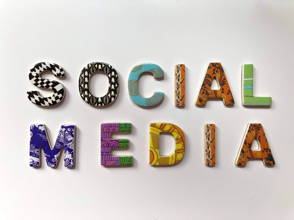 the words social media are spelled out in different colors on a white background