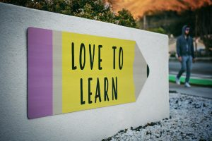 a white sing has a yellow pencil on it with the words love to learn
